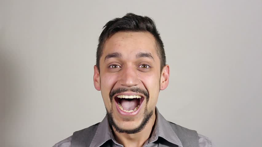 Businessman with a beard laughing and looking at the camera | Shutterstock HD Video #25068866