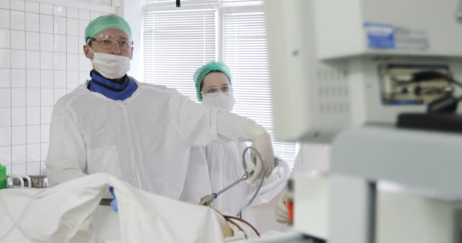 4K Doctor and nurse perform complex operations. Laparoscopic surgery of the abdomen. Clinic. Medicine.