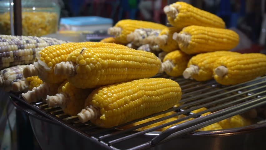 Delicious boiled corn on sale on the streets of bangkok thailand frying corn at night market hd stock video clip ccuart Choice Image