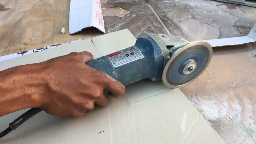 Construction Workers Using Grinder To Cut And Trim Floor Porcelain Tiles Edges At The Site Stock Footage Video 25126076 Shutterstock