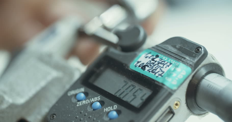 Measurement of metal parts using a micrometer