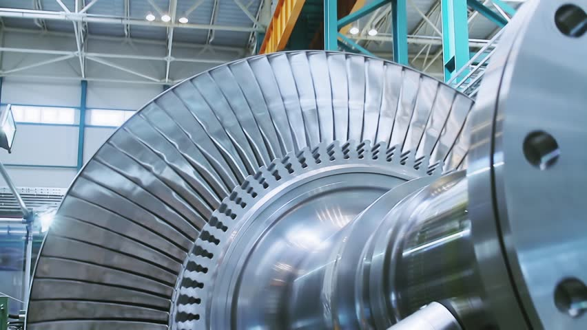 Power steam turbine rotates at a heavy industry plant producing power. Steam turbines and power steam turbine blades