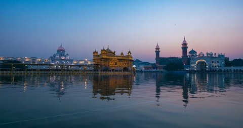 The Golden Temple at Amritsar, Punjab, India, the most sacred icon and worship place of Sikh religion. Time lapse fading from dawn to sunrise.
