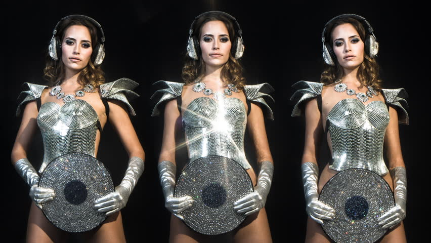 4k amazing sexy woman dances in a sparkling silver costume