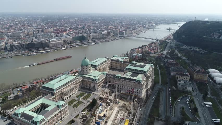 Aerial View of Budapest Royal Palace and surrounding Tourist Attractions and public Areas by the River Donau   Shutterstock HD Video #25338386