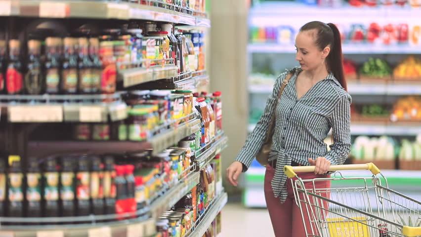 Woman chooses juice in the supermarket | Shutterstock HD Video #25344536