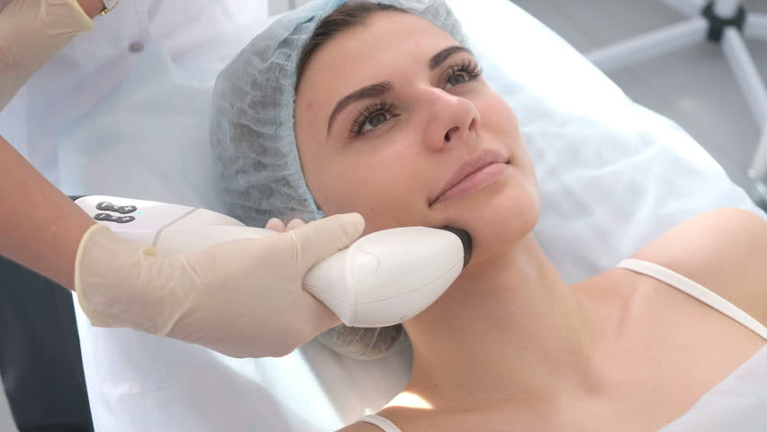 Woman getting rf-lifting in a beauty salon. Woman having a stimulating facial treatment. Skin care face. Skin treatment