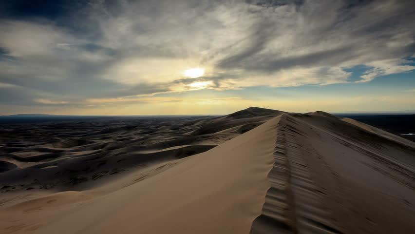 4K. Sunset over the Gobi desert, dune Hongoryn, Mongolia. Ultra HD, 4096x2304