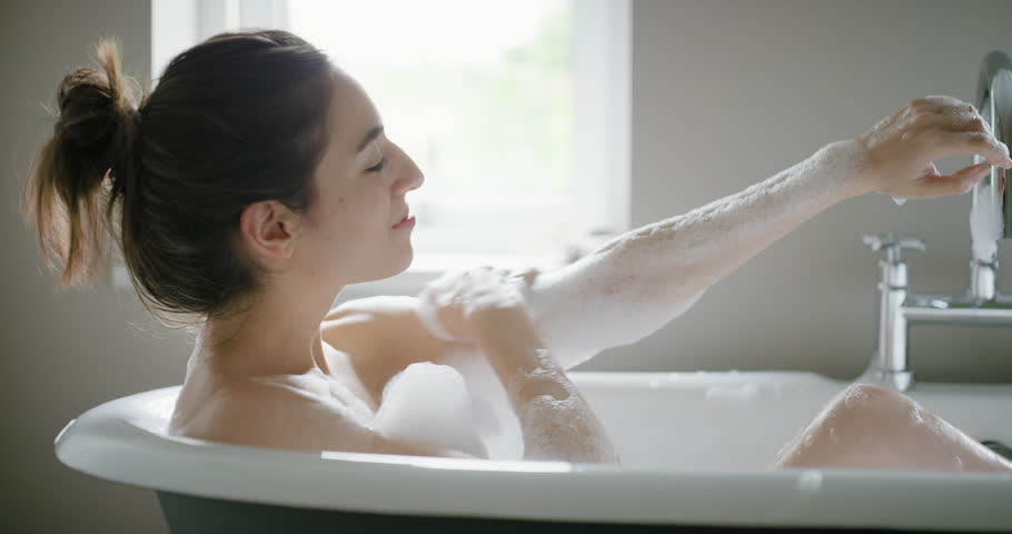 Beautiful Woman enjoying relaxing bubble bath lifestyle real natural body care