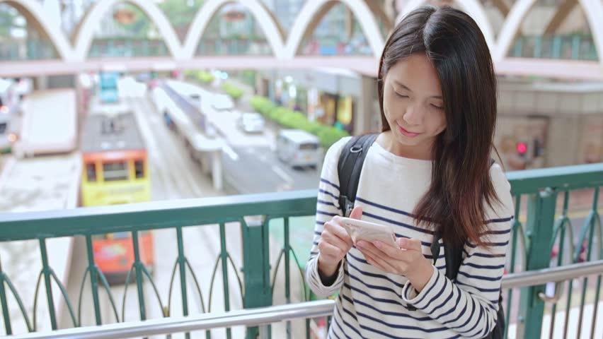 Woman checking location of Hong Kong  | Shutterstock HD Video #25384346