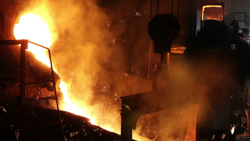 Liquid metal in the foundry, melting iron in furnace, steel mill