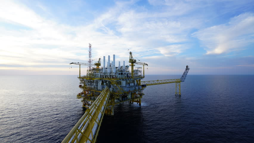 Time lapse in sunset of offshore oil and gas central processing platform in the gulf of Thailand where energy and raw material produced.  | Shutterstock HD Video #25397786