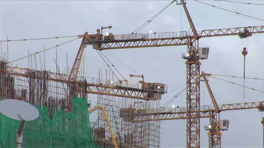 Macau, China - CIRCA March, 2007: Giant cranes at a construction site move the components necessary to build a house