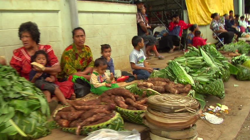 VAVA'U, TONGA - CIRCA 2006: Vendors sell fruits and vegetables in a marketplace is Vava'u, Tonga.