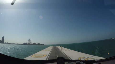 Gyrocopter take off from the runway with sun on the background in Dubai city