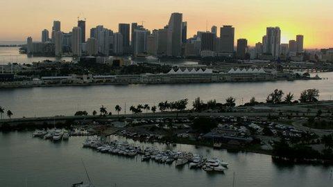 Aerial sunset view of city Skyscrapers McArthur vehicle Causeway bridge ocean Cruise Terminal Condominiums Biscayne Bay Miami Florida USA RED WEAPON