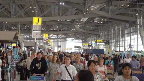 SAMUT PRAKAN, THAILAND - MAR 1, 2016 : People in Passenger Building of Suvarnabhumi Airport is one of two international airports Bangkok, Thailand. The airport is located in Bang Phli, Samut Prakan