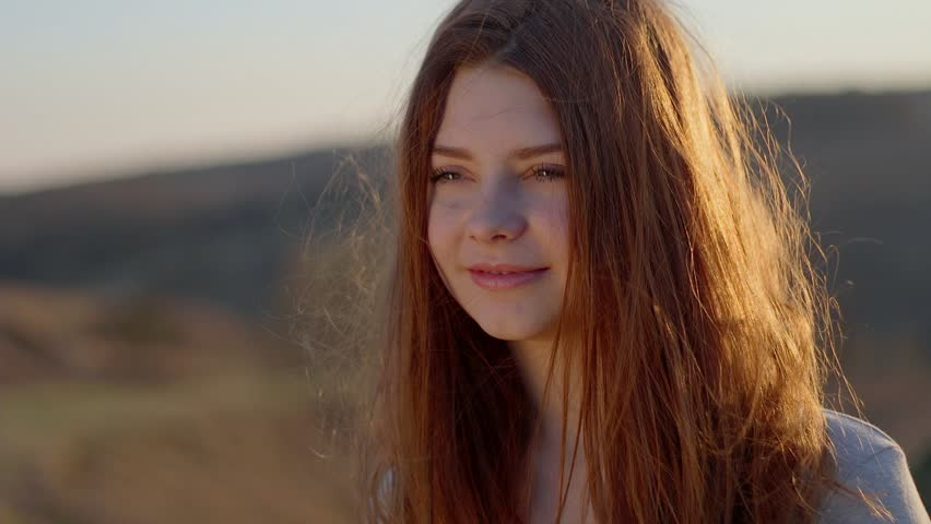 Portrait of a redhead girl at sunset