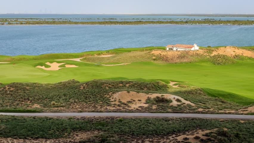 A timelapse video of a golf course in Abu Dhabi. Abu Dhabi - United Arab Emirates 4 April 2017.