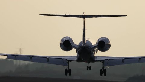 Airplane jet landing in slow motion