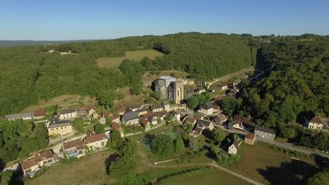 Aerial view by drone of Saint Amant de Coly in summer, classified among the most beautiful villages of France Aquitaine-Limousin-Poitou-Charentes, Saint-Amand-De-Coly, Dordogne, France