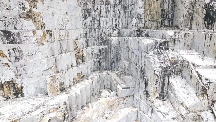 Aerial shot of Italian marble quarries. A beautiful view of the most famous caves in the world.