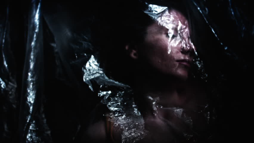 4K Horror Shot Of Dead Woman Waking up in Plastic Bag