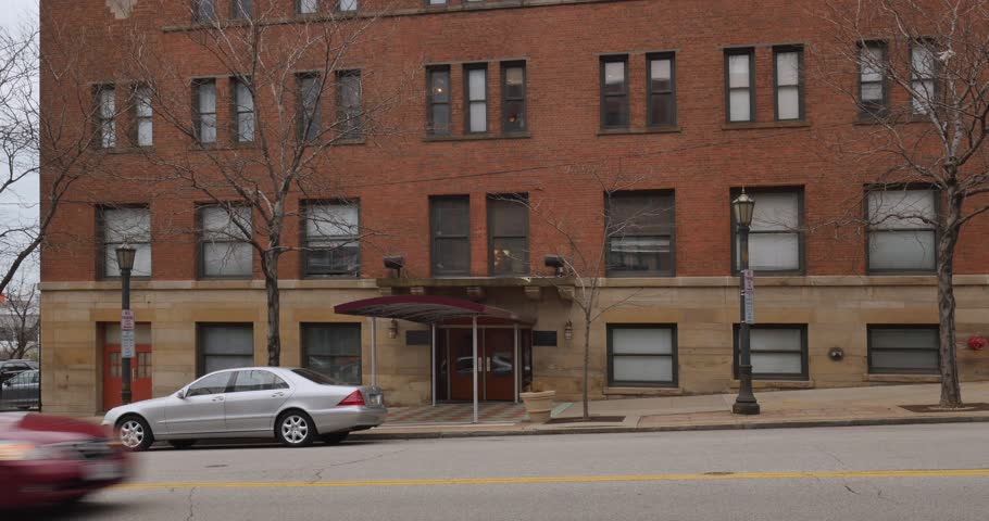 CLEVELAND   Circa March  2017   An overcast daytime establishing shot of  the entrance toDay Hold Across Two Story Older Brick Building An Office Apartment  . Brick Apartment Building Entrance. Home Design Ideas