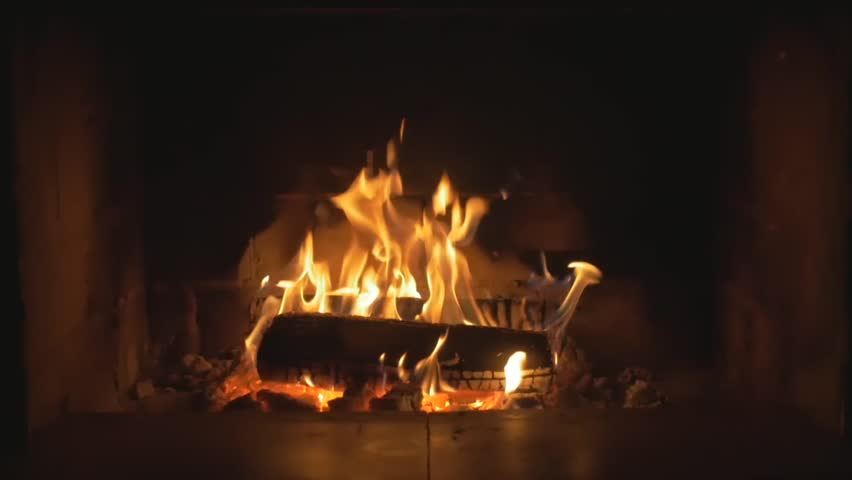 Slow Mo Wood Burning in a Fireplace. Warm cozy fire in a Fireplace. Autumn and Winter holidays. Home cosiness. | Shutterstock HD Video #25633916