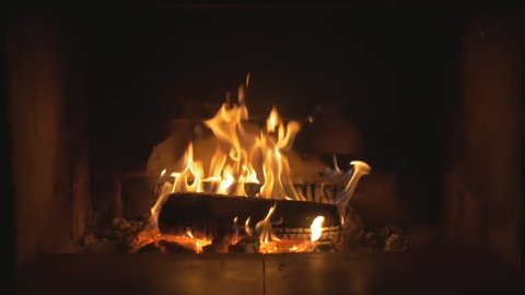 Slow Mo Wood Burning in a Fireplace. Warm cozy fire in a Fireplace. Autumn and Winter holidays. Home cosiness.