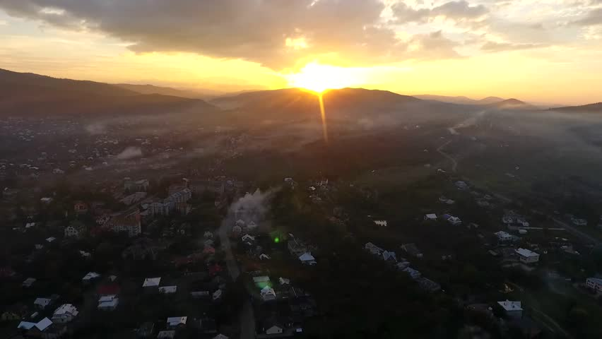 Aerial Stock Footage Flight From Dawn Over Mountain Village with sun dusk | Shutterstock HD Video #25646738