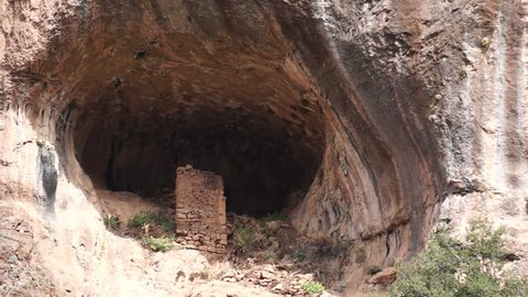 Saint Mikhail Hermitage, Qadisha Valley. CU view of the ruined walls of an ancient hermitage built into a natural cave.