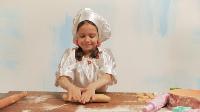 Girl chef rolls the dough by hand. | Shutterstock HD Video #25655366