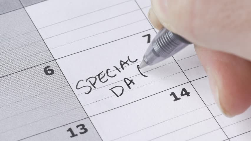 Writing SPECIAL DAY on a calendar to remember this date.