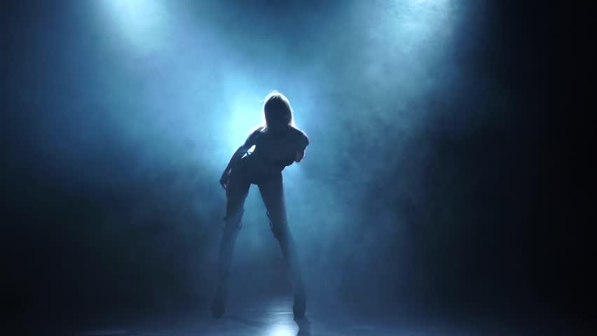 Slender girl pj is dancing in smoky studio, slow motion