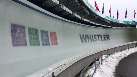 Whistler-Blackcomb, British Columbia, Canada -- March 2017. Public bobsled passes 2010 Vancouver Olympic Sign in ice at Whistler Sliding Centre.