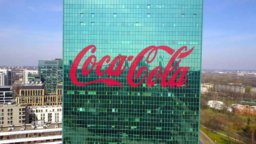 Aerial shot of office skyscraper with Coca-Cola logo. Modern office building. Editorial 3D rendering 4K clip
