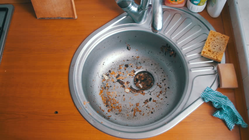 Kitchen Drain Clogging Up With Food Particles. Dirty Clogged Washbasin Sink.  Water And Dirt