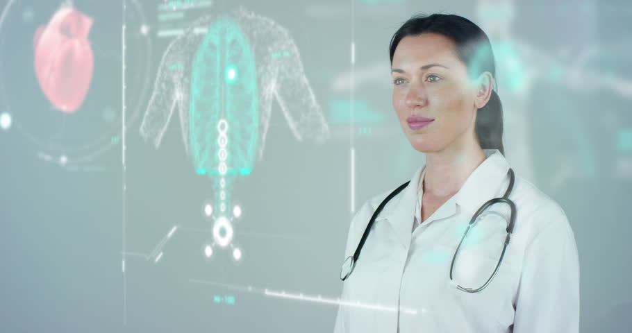 Female doctor with white coat and stethoscope, with holographic tablet represented the patient's body, the heart lungs, muscles, bones. Concept: Futuristic medicine, world assistance, and the future.