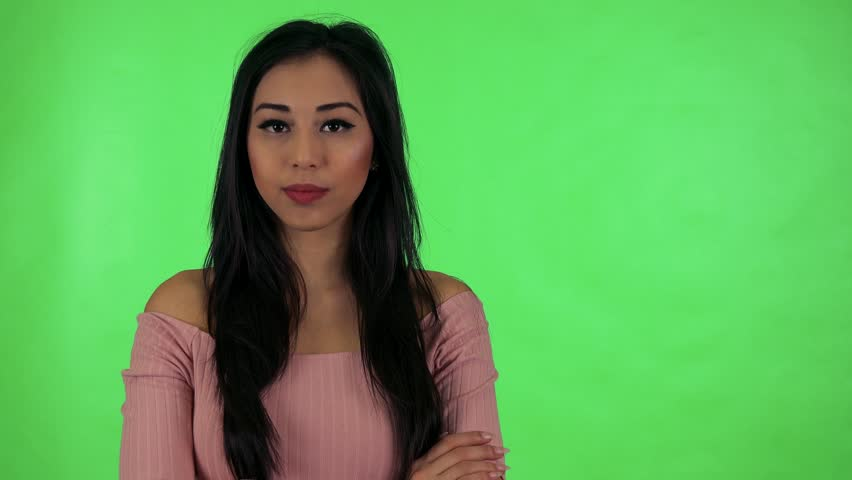 Young attractive asian woman agrees (move with head on yes) - green screen studio | Shutterstock HD Video #25749296