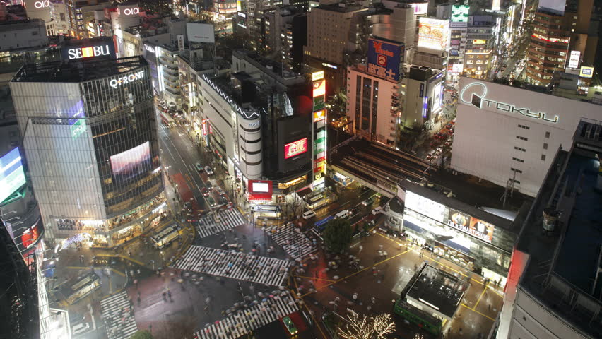 TOKYO, JAPAN - CIRCA MAY 2011: shot pedestrians and traffic across Shibuya Crossing