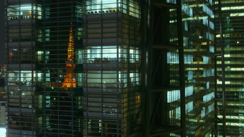 Tokyo business center night view time lapse with famous tokyo tower reflecting in windows | Shutterstock HD Video #25780619