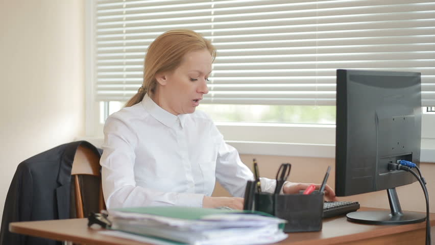 Woman manager tired of work doing physical exercises at the table in the office | Shutterstock HD Video #25816160