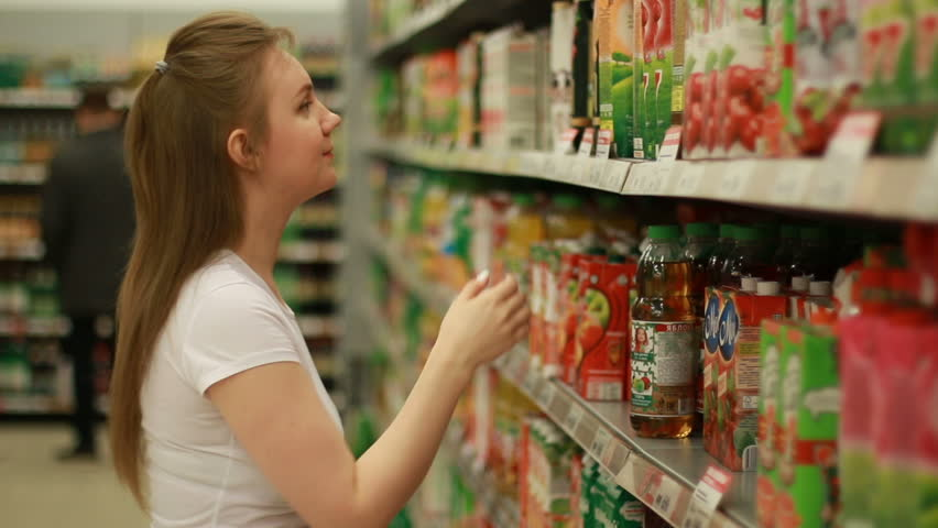 Young woman buy fruit juice at mall | Shutterstock HD Video #25863581