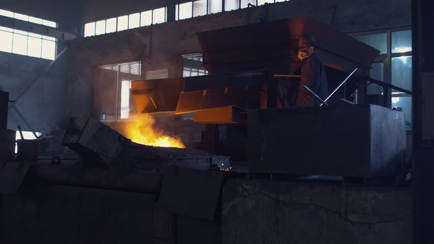 Unrecognizable workers melting metal at the foundry. 4K UHD 60 FPS SLO MO | Shutterstock HD Video #25867466