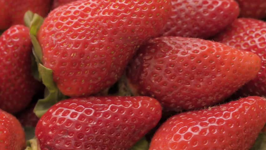 Dolly shot over ripe strawberries, close-up    Shutterstock HD Video #25888526