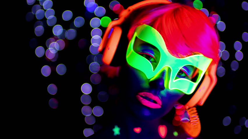 4k fantastic video of sexy cyber raver woman filmed in fluorescent clothing under UV black light   Shutterstock HD Video #25897340