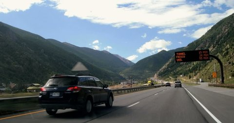 Point of View POV moving driving by Rocky mountain town highway spring summer day I-70 Rocky mountains Vail, Colorado 4K