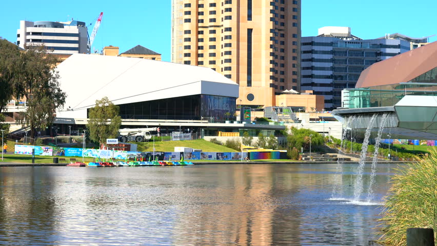 ADELAIDE, SOUTH AUSTRALIA - APRIL 8, 2017: View of Adelaide Riverbank of city business district and Festival Centre taken from across the Torrens River, handheld.