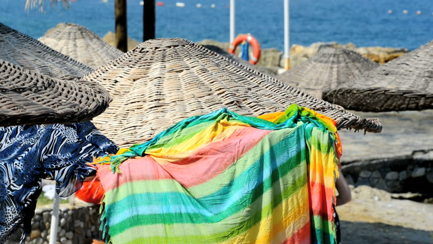 Wicker parasols on the beach  | Shutterstock HD Video #2592596